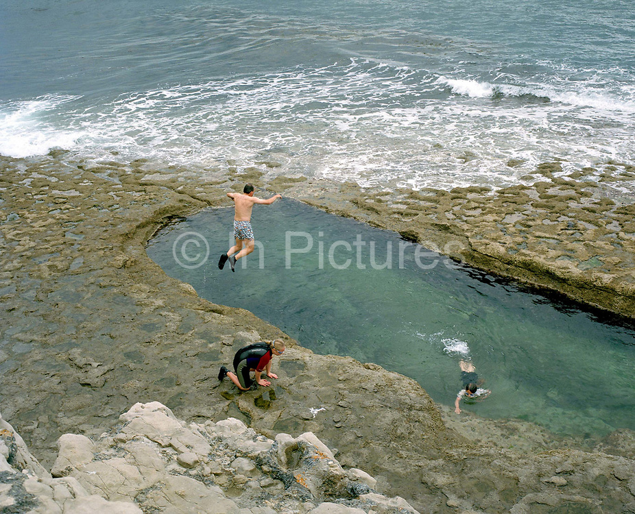 Dancing Ledge, Langton Matravers, Swanage, Dorset. Blasted into the rock to provide bracing exercise for pupils from a nearby prep school, Dancing Ledge was so called because of the area of stone cut from this disused quarry is the size of a ballroom dance floor. Until the 1950s and the rise of the heated indoor swimming pool, children learnt to swim outdoors. For those close to the sea, many man-made tidal swimming pools were constructed around Britain's coastline. Heated by the sun, these tidal pools were often built to keep bathers safe from high and rough seas, which explains why so many of them are clustered in Scotland and around the surfing beaches of Cornwall. Whether they are simple swimming holes made by shoring up natural rock pools or grand lido-like pools complete with lifeguards and tea huts, they are all refreshed by good high tides.