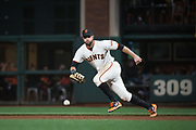 San Francisco Giants first baseman Brandon Belt (9) chases down a Los Angeles Dodgers ground ball at AT&T Park in San Francisco, California, on April 24, 2017. (Stan Olszewski/Special to S.F. Examiner)