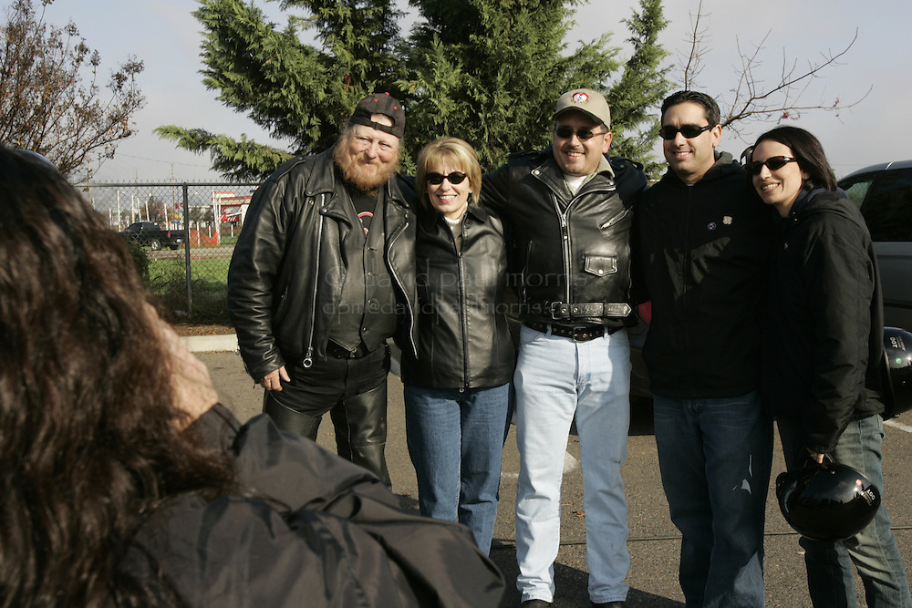 Modesto, CA - NOVEMBER 20:  Mickey Jones, Sharon Rocha, Shawn Rocha, Brent Rocha, and Brent's wife Rose pose for a photograph before the Laci Peterson Memorial ride in Modesto, California. Over 2,000 people took  part in the second annual Laci Peterson Memorial Motorcycle ride in Modesto, California on Saturday November 20, 2004. Laci was murdered along with her unborn son, Conner in December 2002 by her husband Scott Peterson who was found guilty of  first degree of murder by a San Mateo, California jury on November 12, 2004 and could face the death penalty. Photograph by David Paul Morris