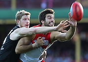 Matthew Lobbe of the Power and Tom Derickx of the Swans contest the ball during the 2014 AFL Round 13 match between the Sydney Swans and Port Adelaide Power at the SCG, Sydney on June 14, 2014. (Photo: Craig Golding/AFL Media)