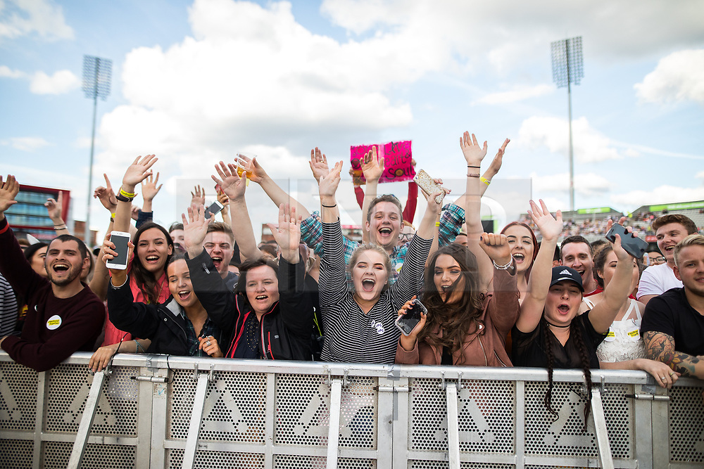 © Licensed to London News Pictures . 04/06/2017 . Manchester , UK . The audience . The One Love Manchester benefit concert for victims of the Manchester Arena terrorist attack , at the Emirates Old Trafford Cricket Stadium . Ariana Grande, Justin Bieber, Coldplay, Katy Perry, Miley Cyrus, Pharrell Williams, Usher, Take That, Robbie Williams, Black Eyed Peas and Niall Horan are amongst the performers. Photo credit : Joel Goodman/LNP