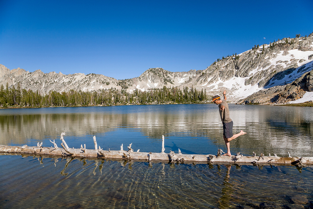 Pierre shows off walking a floating log on Twin Lakes in the Sawtooth Mountains in Idaho.  Licensing and Open Edition Prints.