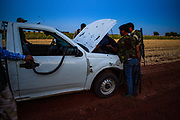 Members of the Free Syrian Army (FSA) are seen checking on their manufactured SUV rocketlauncher follwoing an incident when one of the missiles returned and hit the truck during the military operation in Minaq (Menagh) military airport on Friday, Jun 29, 2012. (Photo by Vudi Xhymshiti)