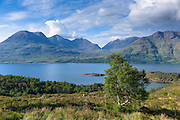 Mountain range by Loch Torridon in Wester Ross, the North West Highlands of Scotland. Beinn Alligin is far left and Beinn Dearg is far right.
