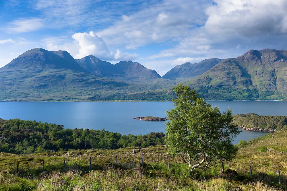 Mountain range by Loch Torridon in Wester Ross, the North West Highlands of Scotland. Beinn Alligin is far left and Beinn Dearg is far right.