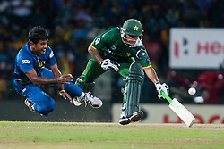 © Licensed to London News Pictures. 04/10/2012. Sri Lankan Nuwan Kulasekara throws in mid air trying to run out Mohammad Hafeez during the World T20 Cricket Mens Semi Final match between Sri Lanka Vs Pakistan at the R Premadasa International Cricket Stadium, Colombo. Photo credit : Asanka Brendon Ratnayake/LNP