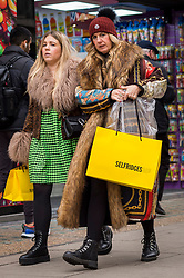 © Licensed to London News Pictures. 12/12/2020. LONDON, UK.  Shoppers in Oxford Street carrying shopping bags as the number of coronavirus cases rises in the capital.  Retailers are hoping that physical sales will pick up in the run up to Christmas.  This comes against a backdrop of two major retailers Debenhams and Arcadia, owner of Topshop, collapsing into administration in recent weeks.  Photo credit: Stephen Chung/LNP