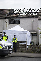 April 27, 2017 - Leeds, Yorkshire, UK - Leeds UK. Picture shows police at the scene of a house fire on Harehills lane in Leeds. A woman has been arrested after a man died following a house fire on Harehills Lane in Leeds early this morning. A man found at the scene was treated by firefighter and paramedics but was pronounced dead at the scene. A 28 year old woman has been arrested on suspicion of manslaughter & production of Cannabis after the remains of a cannabis growing set up were found at the property. (Credit Image: © Andrew Mccaren/London News Pictures via ZUMA Wire)