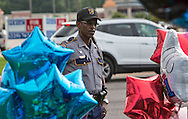 An officer visits a makeshift memorial where six oifficers were shot on Airline Highway in Baton Rouge. Three of the officers were killed and another one remains in criticial condition. The memorial in front of the  B-Quik gas station continues to grow.