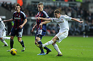Swansea city's Ben Davies ® gets in a shot at goal. Barclays premier league, Swansea city v Stoke city at the Liberty Stadium in Swansea on Saturday 19th Jan 2013. pic by Andrew Orchard, Andrew Orchard sports photography,