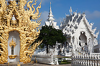 "Wat Rong Khun is unique in Thailand, as its ubosot or consecrated assembly hall is designed in white color and white glass. White color stands for Lord Buddha's purity; the white glass stands for Lord Buddha's wisdom that ""shines brightly all over the Earth and the Universe.""  The creation of Chalermchai Kositpipat - who volunteered to design the temple at his own expense as an offering to Lord Buddha - he later altered the plan in such a way that Wat Rong Khun developed into a prominent site attracting both Thai and foreign visitors."