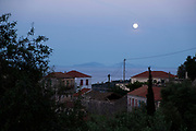 Moon in Kioni, Ithaca, Greece. Ithaca, Ithaki or Ithaka is a Greek island located in the Ionian Sea to the west of continental Greece. Ithacas main island has an area of 96 square kilometres. It is the second-smallest of seven main Ionian Islands.