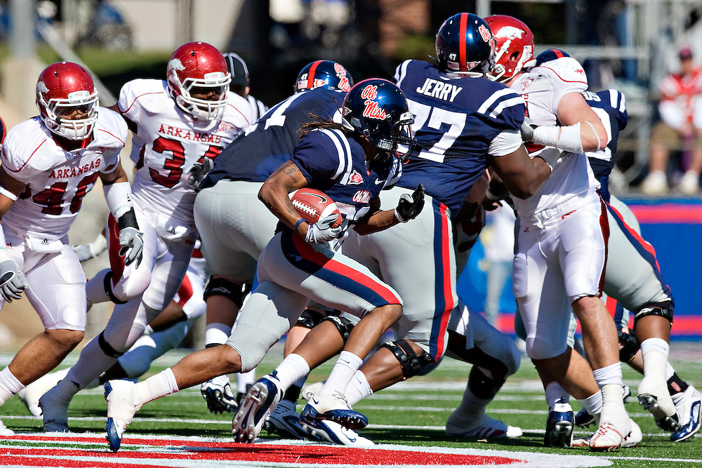 OXFORD, MS - OCTOBER 24:   Dexter McCluster #22 of the Ole Miss Rebels runs with the ball behind the blocks of his offensive line against the Arkansas Razorbacks at Vaught-Hemingway Stadium on October 24, 2009 in Oxford, Mississippi.  The Rebels defeated the Razorbacks 30 to 17.  (Photo by Wesley Hitt/Getty Images) *** Local Caption *** Dexter McCluster