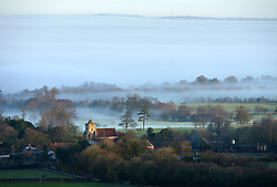 © Licenced to London News Pictures. 22-12-16 Firle, East Sussex. Misty morning in Firle, East Sussex on a calm day before Storm Barbara hits the UK. Credit: Peter Cripps/LNP