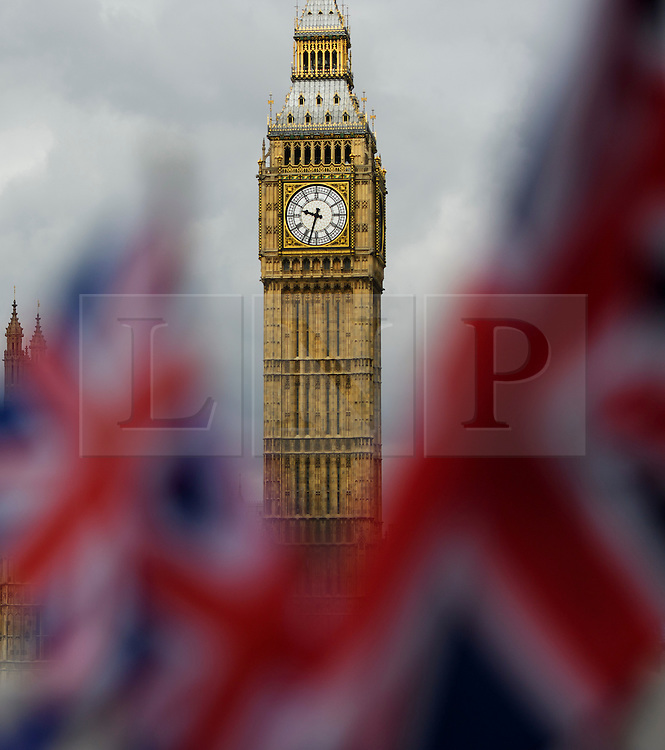 © Licensed to London News Pictures. 24/06/2016. London, UK. Union flags wave in front of The House of Parliament in Westminster, London on the day that the UK voted to leave the EU in a referendum. Photo credit: Ben Cawthra/LNP