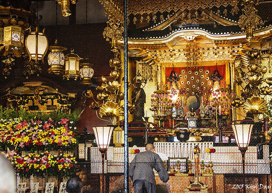 Monk praying inside Senso-ji Shrine<br /> Asakusa, Tokyo<br /> May 2015