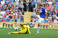 Everton's Nikica Jelavic has a shot blocked by Cardiff keeper David Marshall.  Barclays Premier league, Cardiff city v Everton at the Cardiff city Stadium in Cardiff,  South Wales on Saturday 31st August 2013. pic by Andrew Orchard,  Andrew Orchard sports photography,