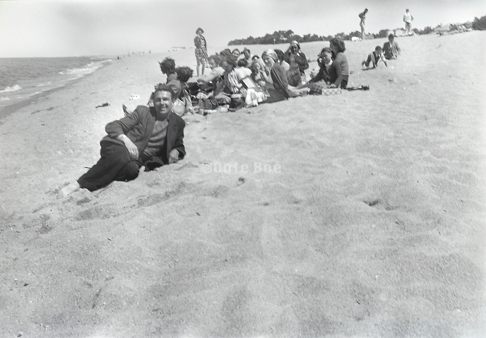 group of people at the beach 1950s