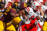 Ameer Abdullah looks for running room at Minnesota on Oct. 26, 2013. © Aaron Babcock