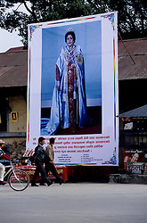 Picture of her Majesty the Queen displayed in the street of the city.