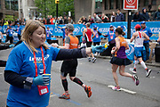 Lucozade being handed out in capsule form at the London Marathon on 28th April 2019 in London, England, United Kingdom. The London Marathon, presently known through sponsorship as the Virgin Money London Marathon, is a long-distance running event. The event was first run in 1981 and has been held in the spring of every year since. The race is mainly known for ebing a public race where ordinary people can challenge themsleves while raising great amounts of money for various charities.