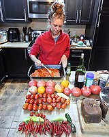 Chloe making Pizza with fresh ingredients from my garden. Image taken with a Leica T camera and 11-23 mm lens