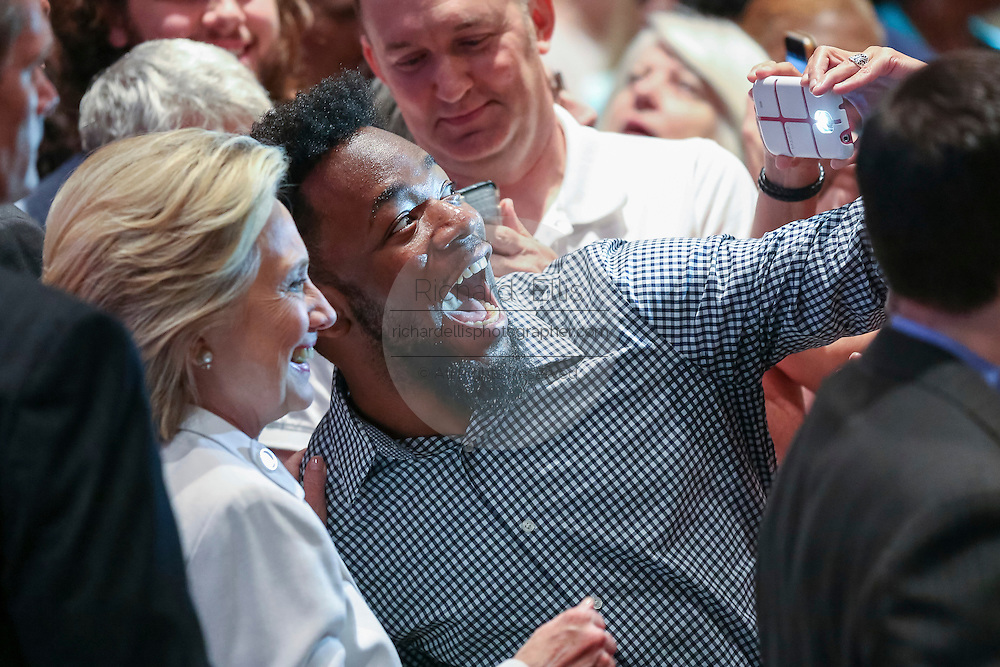Former Secretary of State and Democratic presidential candidate Hillary Rodham Clinton takes a selfie with a supporter during a campaign event at Trident Tech June 17, 2015 in North Charleston, South Carolina.