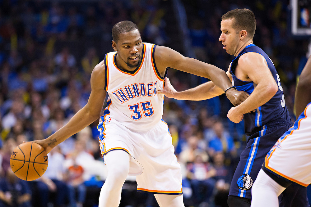 OKLAHOMA CITY, OK - JANUARY 13:  Kevin Durant #35 of the Oklahoma City Thunder drives to the basket against Jose Juan Barea #5 of the Dallas Mavericks at Chesapeake Energy Arena on January 13, 2016 in Oklahoma City, Oklahoma.  NOTE TO USER: User expressly acknowledges and agrees that, by downloading and or using this photograph, User is consenting to the terms and conditions of the Getty Images License Agreement.   The Thunder defeated the Mavericks 108-89.  (Photo by Wesley Hitt/Getty Images) *** Local Caption *** Kevin Durant; Jose Juan Barea