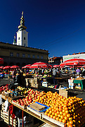 Dolac open market, with gilded clock tower of Saint Mary's church in background, Zagreb, Croatia