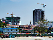 """13 FEBRUARY 2019 - SIHANOUKVILLE, CAMBODIA: Chinese casinos under construction near Ocherteal Beach in Sihanoukville. There are about 80 Chinese casinos and resort hotels open in Sihanoukville and dozens more under construction. The casinos are changing the city, once a sleepy port on Southeast Asia's """"backpacker trail"""" into a booming city. The change is coming with a cost though. Many Cambodian residents of Sihanoukville  have lost their homes to make way for the casinos and the jobs are going to Chinese workers, brought in to build casinos and work in the casinos.      PHOTO BY JACK KURTZ"""