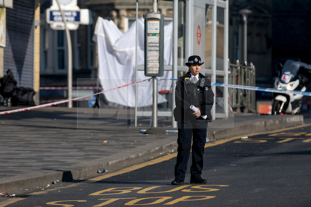 © Licensed to London News Pictures. 27/02/2019. London, UK. A policewoman at the scene outside Ilford Station, where a 20-year-old man was fatally stabbed last night. A murder investigation has been launched. Photo credit: Rob Pinney/LNP