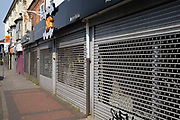 Local response to Coronavirus is felt on a street by street level as restaurants, shops and small businesses are closed up with their shutters pulled down on Ladypool Road on 10th April 2020 in Birmingham, England, United Kingdom. Coronavirus or Covid-19 is a new respiratory illness that has not previously been seen in humans. While much or Europe has been placed into lockdown, the UK government has announced more stringent rules as part of their long term strategy, and in particular social distancing.