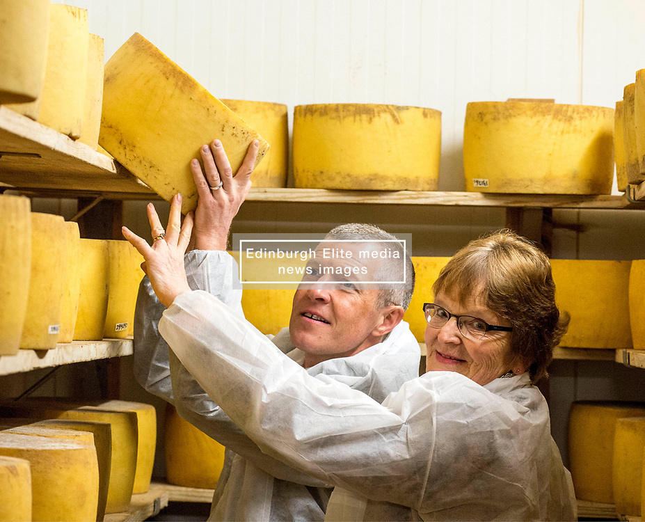 Scottish Lib Dem leader Willie Rennie gets to grips with one of the cheeses along with local candidate Elizabeth Richef when he visited St Andrews Farmhouse Cheese Company in Pitenweem in Fife in the run up to the 2017 General Election.<br /> © Dave Johnston/ EEm