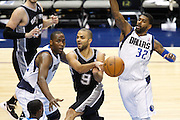 San Antonio Spurs point guard Tony Parker (9) passes the ball in the lane between Dallas Mavericks point guard Darren Collison (4) and O.J. Mayo (32) at American Airlines Center in Dallas, Texas, on January 25, 2013.  (Stan Olszewski/The Dallas Morning News)