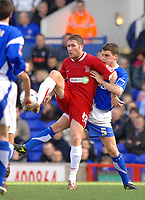 Photo: Ashley Pickering.<br />Ipswich Town v Southend United. Coca Cola Championship. 10/03/2007.<br />Lee Bradbury of Southend (L) shields the ball from Alex Bruce of Ipswich