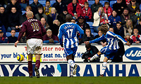 Photo: Jed Wee.<br />Wigan Athletic v Arsenal. The Barclays Premiership.<br />19/11/2005.<br />Wigan's Jimmy Bullard (R) fires in their second goal.