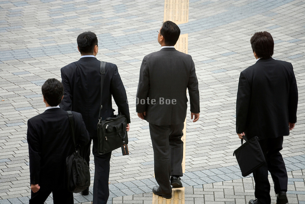 businessmen on their way to a meeting