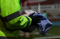 A groundsman wipes a match ball before putting it beside the pitch<br /> <br /> Photographer Alex Dodd/CameraSport<br /> <br /> The EFL Sky Bet Championship - Rotherham United v Sheffield Wednesday - Wednesday 28th October 2020 - New York Stadium - Rotherham<br /> <br /> World Copyright © 2020 CameraSport. All rights reserved. 43 Linden Ave. Countesthorpe. Leicester. England. LE8 5PG - Tel: +44 (0) 116 277 4147 - admin@camerasport.com - www.camerasport.com