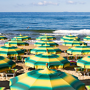 Umbrellas on a beach near the town of Sperlonga, Italy.