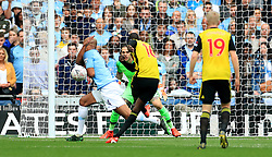 Watford's Abdoulaye Doucoure (centre) has a shot on goal which strikes Manchester City's Vincent Kompany (left) on the arm but no handball is given during the FA Cup Final at Wembley Stadium, London.