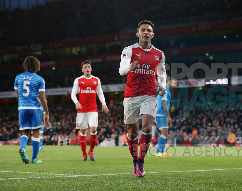 Arsenal's Alexis Sanchez celebrates scoring his sides third goal during the Premier League match at the Emirates Stadium, London. Picture date October 26th, 2016 Pic David Klein/Sportimage