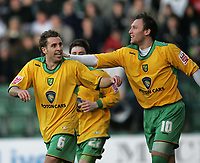 Photo: Lee Earle.<br /> Plymouth Argyle v Norwich City. Coca Cola Championship.<br /> 14/01/2006. Norwich's Dean Ashton (R) congratulates Darren Huckerby on his equalising goal.