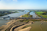Nederland, Gelderland, Nijmegen, 24-10-2013; <br /> De nieuwe stadsbrug van Nijmegen, De Oversteek.<br /> grondwerkzaamheden voor de dijkteruglegging Lent (Ruimte voor de Rivier). De dijken worden landinwaarts verplaatst en er wordt een nevengeul voor rivier de Waal gegraven. <br /> The new city bridge of Nijmegen on the river Waal, De Oversteek (The Crossing).  Groundworks for the Dike relocation of Lent (project Ruimte voor de Rivier: Room for the River). <br /> luchtfoto (toeslag op standaard tarieven);<br /> aerial photo (additional fee required);<br /> copyright foto/photo Siebe Swart.