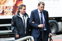 © Licensed to London News Pictures. 19/08/2019. London, UK.  Lord Chris Holmes of Richmond (L) arrives at Southwark Crown Court in London today, accused of sexual assault. Nine-time Paralympic swimming champion, Holmes is accused of touching the alleged victim at a hotel in central London. Photo credit: Vickie Flores/LNP