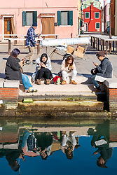 Tourists checking their phones in Burano, a small island in the Venice lagoon. From a series of travel photos in Italy. Photo date: Tuesday, February 12, 2019. Photo credit should read: Richard Gray/EMPICS