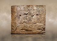 Photo of Hittite relief sculpted orthostat stone panel of Long Wall Limestone, Karkamıs, (Kargamıs), Carchemish (Karkemish), 900-700 B.C. Anatolian Civilisations Museum, Ankara, Turkey<br /> <br /> Two figures lying over the lion. There is a crescent at the head of the winged god at the front. It is thought that the figure at the front is moon god and the one at the rear is sun god. <br /> <br /> On a brown art background. .<br />  <br /> If you prefer to buy from our ALAMY STOCK LIBRARY page at https://www.alamy.com/portfolio/paul-williams-funkystock/hittite-art-antiquities.html  - Type  Karkamıs in LOWER SEARCH WITHIN GALLERY box. Refine search by adding background colour, place, museum etc.<br /> <br /> Visit our HITTITE PHOTO COLLECTIONS for more photos to download or buy as wall art prints https://funkystock.photoshelter.com/gallery-collection/The-Hittites-Art-Artefacts-Antiquities-Historic-Sites-Pictures-Images-of/C0000NUBSMhSc3Oo