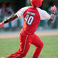 15 February 2009: Catcher Rolando Merino of the Orientales hits the ball during a training game of Cuba Baseball Team for the World Baseball Classic 2009. The national team is pitted against itself, divided in two teams called the Occidentales and the Orientales. The Orientales win 12-8, at the Latinoamericano stadium, in la Habana, Cuba.