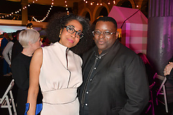 Artist ISAAC JULIEN and his wife at The Naked Heart Foundation's Fabulous Fund Fair hosted by Natalia Vodianova and Karlie Kloss at Old Billingsgate Market, 1 Old Billingsgate Walk, London on 20th February 2016.