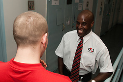 Prison officer in a one to one with a prisoner on a landing UK prison
