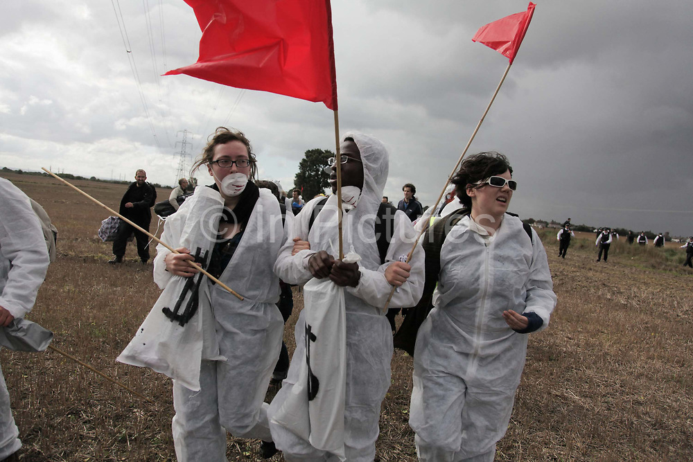 Climate activists from the Building Block, one of three grops of activists, are making their way across fields and passed police to join the ongoing blockade of Coryton oil refinery.<br /> <br /> Crude Oil Awakening is a coalition of climate change activist groups. On Saturday Oct 16 they shut the only entrance to Coryton oil refinery in Essex, UK with the aim of highlighting the issues of climate change and the burning of fossil fuels. The blockade meant that a great number of trucks with oil were not able to leave the refinary during the day of action.